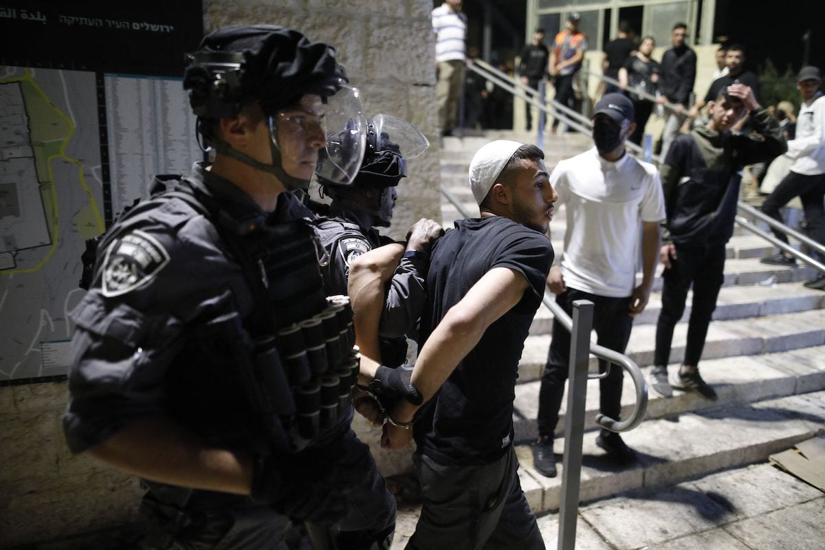 Israeli security forces detain a Palestinian protester outside the Damascus Gate in Jerusalem's Old City on 29 April 2021. [AHMAD GHARABLI/AFP via Getty Images]