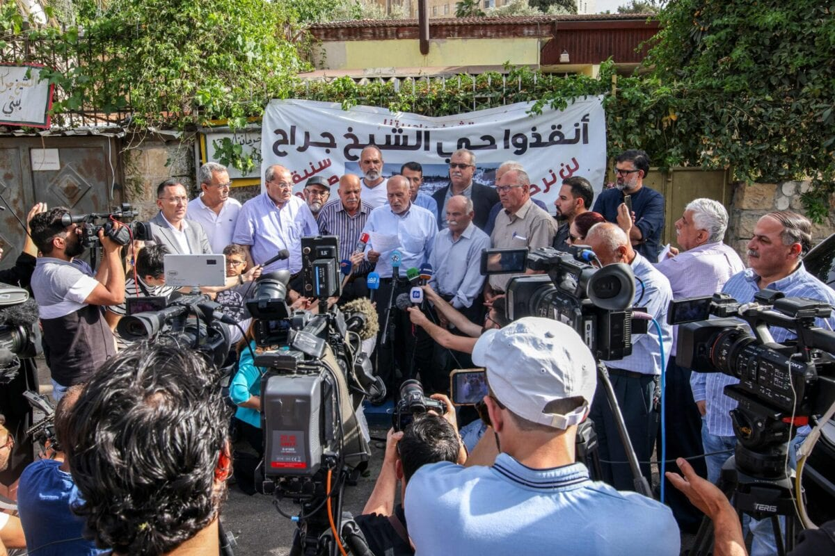 Ahmed Tibi (centre 3rd-L), member of the Knesset for the Joint List and leader of the Arab Movement for Change (Ta'al) party, alongside ex-Knesset member Jamal Zahalka (centre 2nd-L), attend a press conference held by local elders of the Sheikh Jarrah neighbourhood of Israeli-annexed east Jerusalem, on May 6, 2021, where the locals requested help from the Palestinian Authority and Jordan regarding the legal status of their homes [AHMAD GHARABLI/AFP via Getty Images]