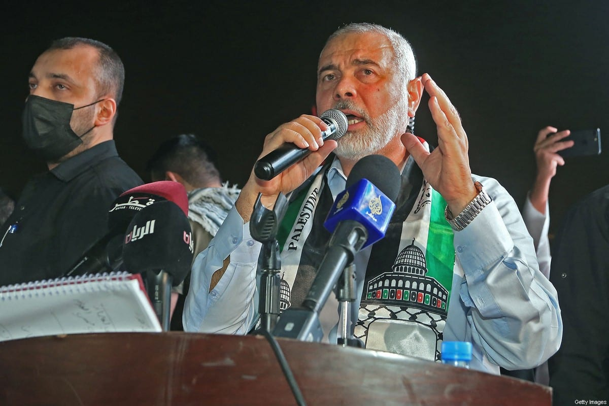 Hamas' political bureau chief Ismail Haniyeh addresses supporters during a rally in solidarity with the Palestinians outside Qatar's Imam Muhammad Abdel-Wahhab Mosque in the capital Doha on May 15, 2021 [KARIM JAAFAR/AFP via Getty Images]