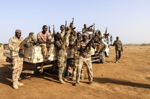 Fighters from a Saudi-backed Sudanese-Yemeni military force battling Huthi rebels are pictured on May 23, 2021 near the border with Saudi Arabia in Yemen's northern coastal town of Midi [MOHAMMED AL-WAFI/AFP via Getty Images]