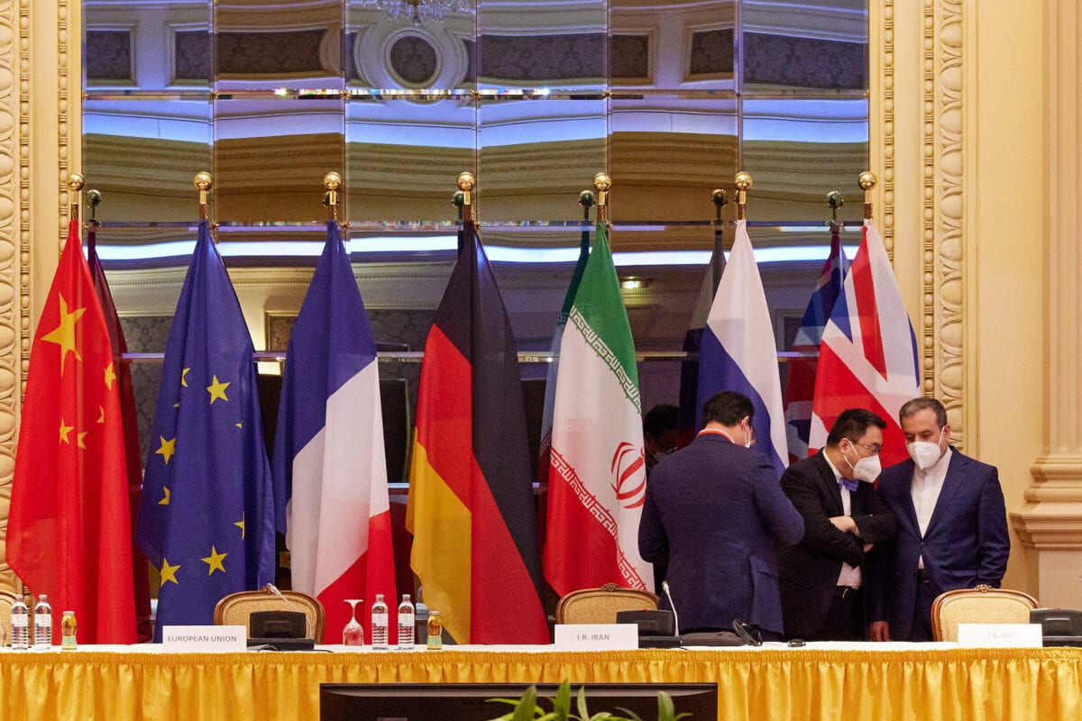 In this handout image provide by EU Delegation Vienna, Iranian Deputy Foreign Minister Abbas Araghchi (R) speaks with other participants at the JCPOA Iran nuclear talks on April 27, 2021 in Vienna, Austria [EU DELEGATION VIENNA via Getty Images]