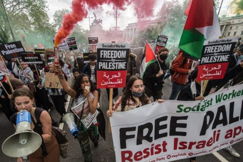 A huge demonstration of tens of thousands of people marches from the Embankment to Hyde park in solidarity with the Palestinian people on May 22, 2021 in London, England [Guy Smallman/Getty Images]