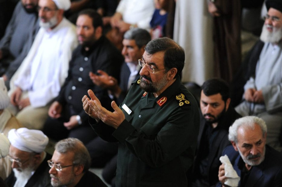 """TEHRAN, IRAN - JULY 10: Mohsen Rezaei, a former Iranian Revolutionary Guard commander and two-time presidential candidate (in uniform), stands during Friday Prayers during a Qods (Jerusalem) Day rally, an annual pro-Palestinian event, in Tehran, Iran, on July 10, 2015. Rally-goers turned out in cities across Iran, chanting """"Death to America"""" and """"Death to Israel,"""" as Iran negotiates the final rounds of a nuclear deal with six world powers in Vienna, Austria. (Photo by Scott Peterson/Getty Images)"""