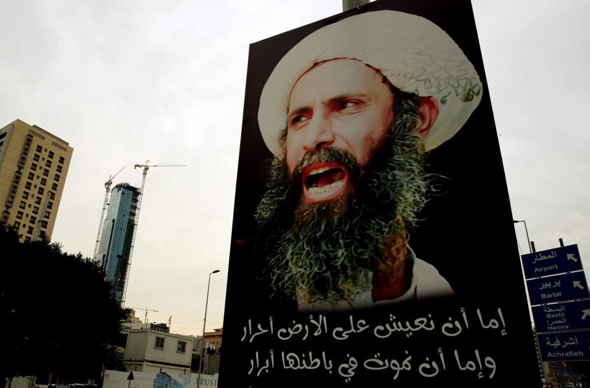 A portrait of late prominent Shia Muslim cleric Nimr al-Nimr is seen hanging on an electricity pole in the Lebanese capital, Beirut, on January 7, 2016 [JOSEPH EID/AFP via Getty Images]