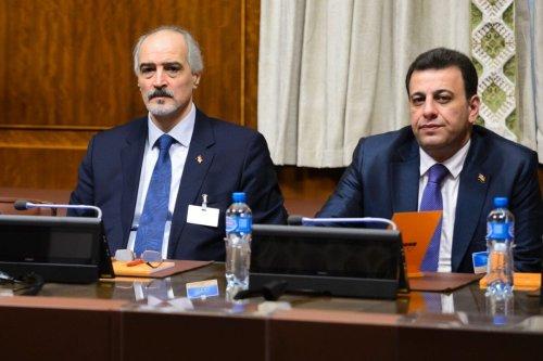 Syrian ambassador to UN and head of the government delegation Bashar al-Jaafari (L) in Geneva on January 29, 2016 [FABRICE COFFRINI/AFP via Getty Images]