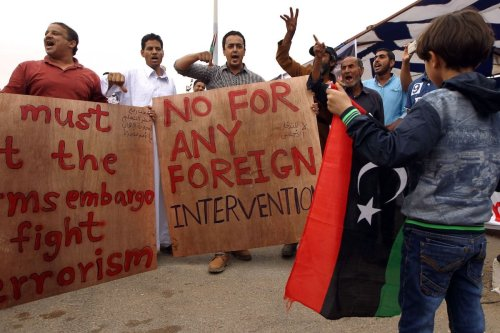 Libyans hold banners as they take part demonstration in the eastern coastal city of Benghazi calling for military forces to re-capture the southern city of Sirte from the Islamic State (IS) group without foreign intervention on 6 May 2016. [ABDULLAH DOMA/AFP via Getty Images]