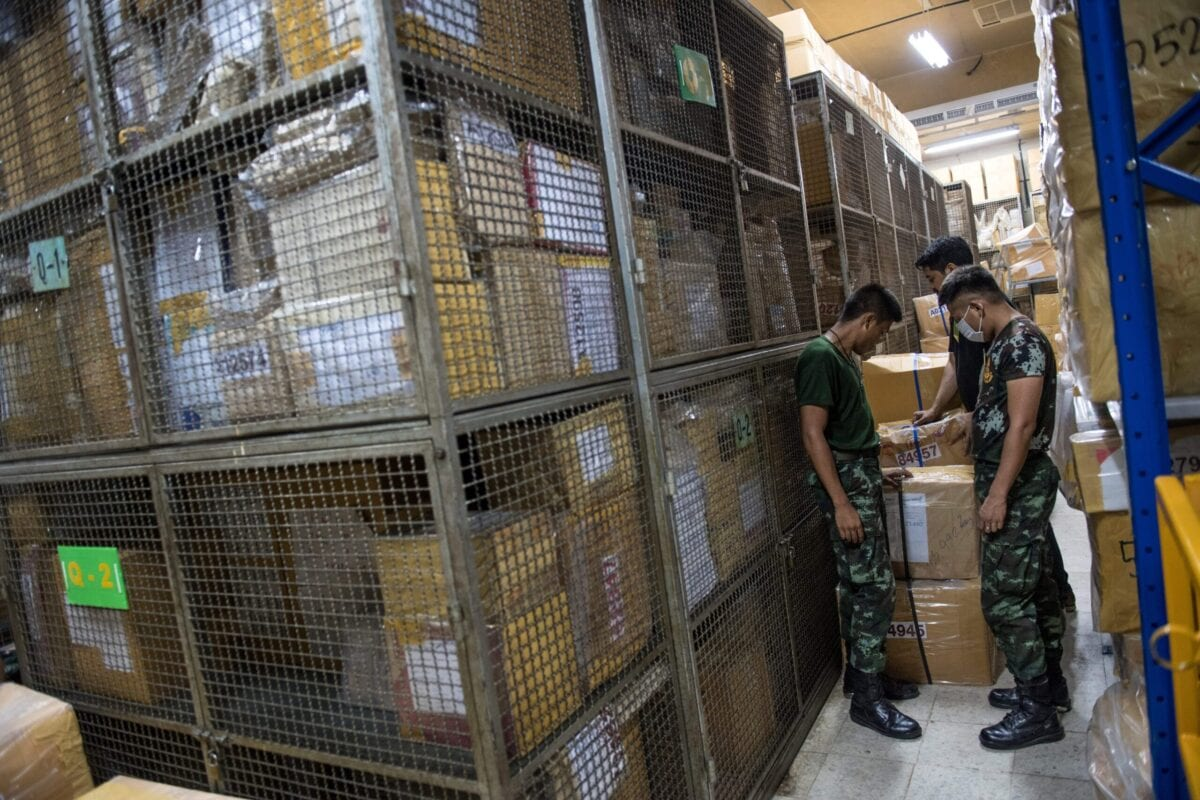 Army soldiers look at boxes containing confiscated amphetamine and ICE pills on June 23, 2017 [ROBERTO SCHMIDT/AFP via Getty Images)]