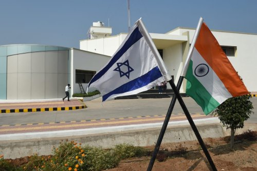The national flags of Israel and India stand in the campus of the Centre of Excellence for Vegetables at Vadrad village, some 70 kms from Ahmedabad, on 12 January 2018. [SAM PANTHAKY/AFP via Getty Images]