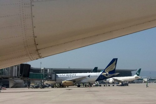 Planes sit on the tarmac at the newly built Islamabad International Airport on May 8, 2018. - Pakistan's long-awaited Islamabad new airport opened its doors on May 3, after years of delays and setbacks that exposed the difficulty of building modern infrastructure in the country. (Photo by AAMIR QURESHI / AFP) (Photo credit should read AAMIR QURESHI/AFP via Getty Images)