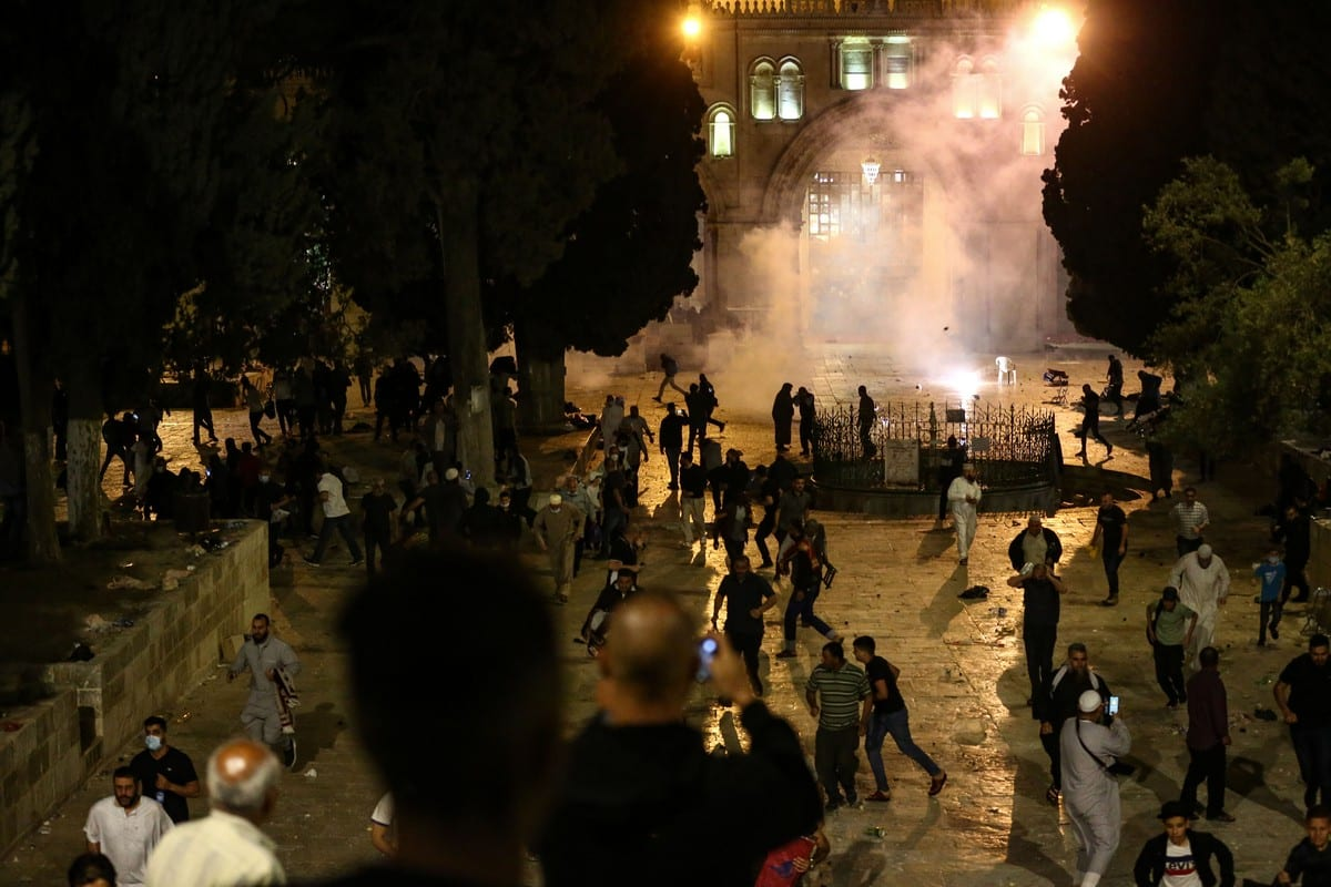 Israeli police fire tear gas at worshippers at the Al-Aqsa Mosque compound on 7 May 2021 in East Jerusalem [Mostafa Alkharouf/Anadolu Agency]