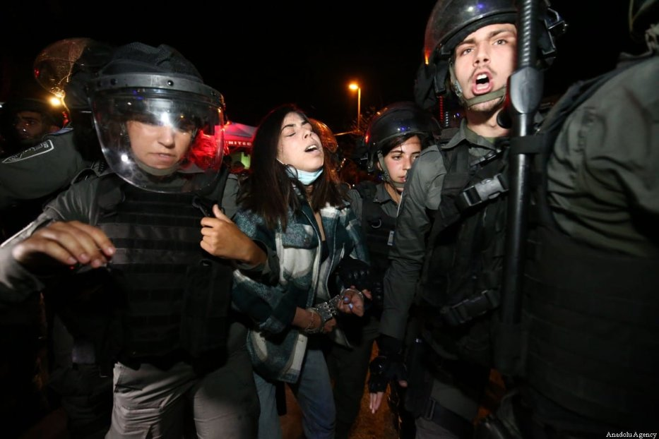 JERUSALEM - MAY 05: Israeli forces take a Palestinian woman into custody during a demonstration at Sheikh Jarrah neighborhood after Israeli government's plan to force some Palestinian families out of their homes in East Jerusalem on May 05, 2021. ( Mostafa Alkharouf - Anadolu Agency )