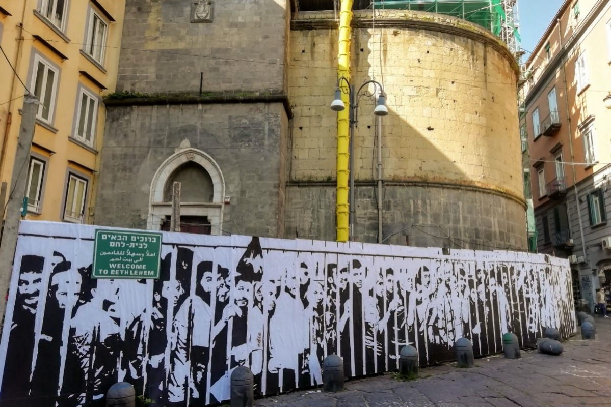 "The mural called ""Welcome to Bethlehem"", depicts Palestinian workers lining up at an Israeli military checkpoint near Bethlehem in the occupied West Bank, appears in the Italian city of Naples, by the well-known Italian artist and photographer, Eduardo Castaldo."