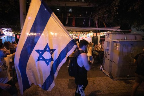 Thousands of Israelis celebrate the country's new government, ending the 12-year reign of Premier Benjamin Netanyahu at Rabin Square in Tel Aviv, Israel on June 13, 2021 [Eyad Tawil / Anadolu Agency]