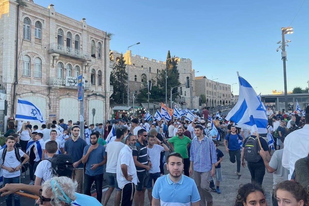 "Far-right Israelis holding Israeli flags stage ""flag march"" starting from Ha-Nevi'im Street towards Damascus Gate (Bab al-Amud) in OId Town neighborhood of Jerusalem on 15 June 2021. [Esat Fırat - Anadolu Agency]"