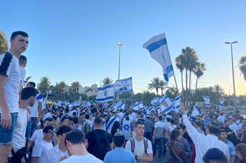 "JERUSALEM - JUNE 15: Far-right Israelis holding Israeli flags stage ""flag march"" starting from Ha-Nevi'im Street towards Damascus Gate (Bab al-Amud) in OId Town neighborhood of Jerusalem on June 15, 2021. ( Esat Fırat - Anadolu Agency )"