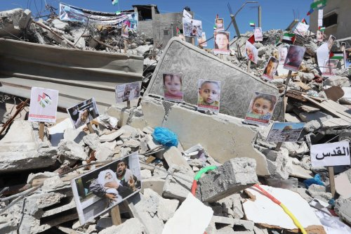 Photos of children, who lost their lives in Israel's attacks on Gaza, are exhibited at debris of Es-Sekka family's house in Khan Yunis, Gaza on 19 June 2021. [Ashraf Amra - Anadolu Agency]
