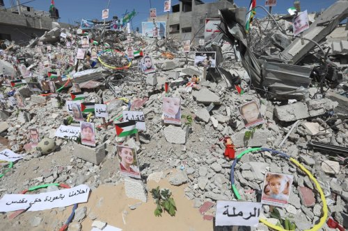 Photos of children, who lost their lives in Israel's attacks on Gaza, are exhibited at debris of Es-Sekka family's house in Khan Yunis, Gaza on June 19, 2021 [Ashraf Amra / Anadolu Agency]