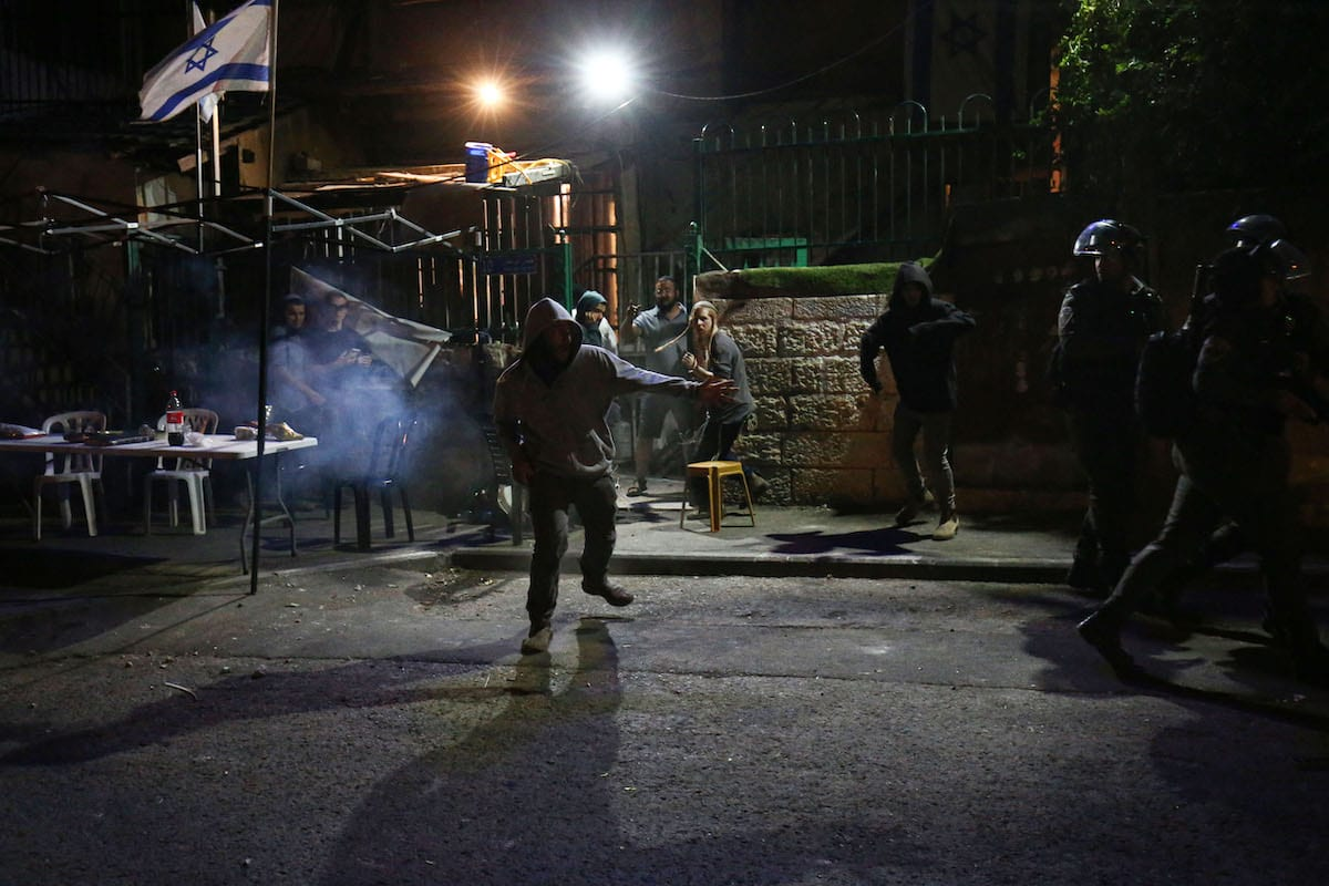 Israeli police officers intervene Palestinians with sound bombs and tear gas canisters after Jewish settlers attacked Palestinians in the Sheikh Jarrah neighborhood of East Jerusalem on 22 June 2021. [Mostafa Alkharouf - Anadolu Agency]