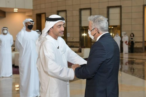 Isreali Foreign Minister Yair Lapid (R) is welcomed by Minister of Foreign Affairs and International Cooperation of the United Arab Emirates, Sheikh Abdullah bin Zayed bin Sultan Al Nahyan (L) in Abu Dhabi, United Arab Emirates on 29 June 2021. [Government Press Office of Israel - Anadolu Agency]