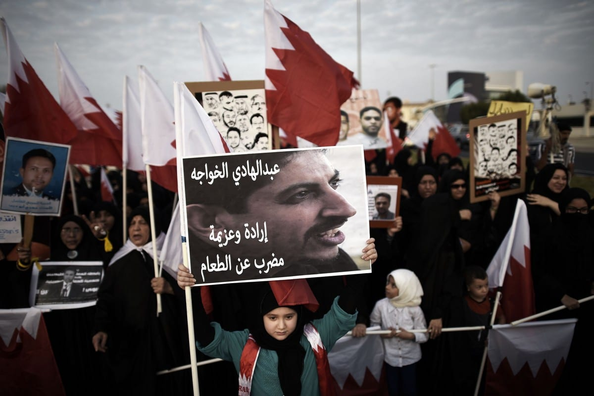 A Bahraini girl holds up a placard bearing a portrait of jailed human rights activist Abdulhadi Al-Khawaja in Manama, Bahrain on 5 September 2014 [MOHAMMED AL-SHAIKH/AFP/Getty Images]