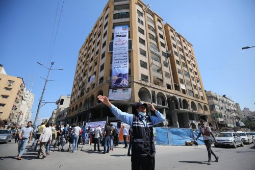 The Palestinian Media Forum launched 'Sahafa Square' (Journalism Square) in Gaza in front of the destroyed Al-Jawhara Tower which housed media companies, 23 June 2021 [Mohammed Asad/Middle East Monitor]