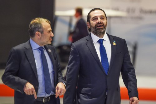 Lebanese Prime Minister Saad Hariri (R) along with Foreign Minister Gebran Bassil arrive to the International Congress Centre on February 24, 2019 [MOHAMED EL-SHAHED/AFP via Getty Images]