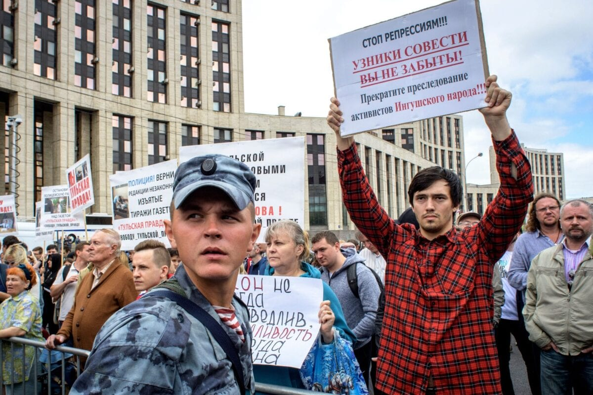 People hold posters during a rally in defence of freedom of speech and journalism in central Moscow on June 16, 2019 [YURI KADOBNOV/AFP via Getty Images]