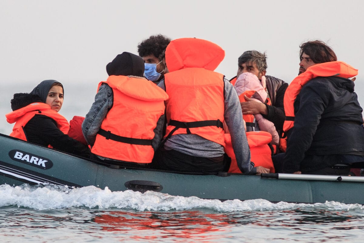 Migrants, including women and children, in a dinghy, illegally cross the English Channel from France to Britain on September 11, 2020 [SAMEER AL-DOUMY/AFP via Getty Images]