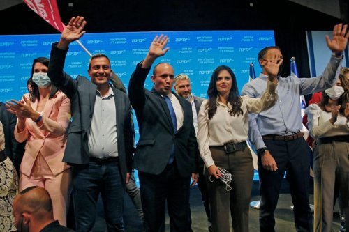 Naftali Bennett (C), leader of the Israeli right-wing Yamina ('New Right') party, accompanied by party candidate Ayelet Shaked (C-R) in Tel Aviv on March 24, 2021 [GIL COHEN-MAGEN/AFP via Getty Images]