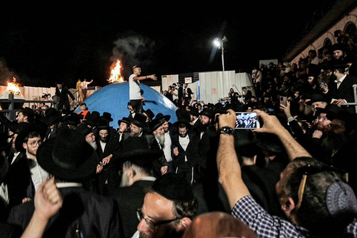 Ultra-Orthodox Jews gather around a bonfire at the grave site of Rabbi Shimon Bar Yochai at Mount Meron in northern Israel on April 29, 2021 [JALAA MAREY/AFP via Getty Images]
