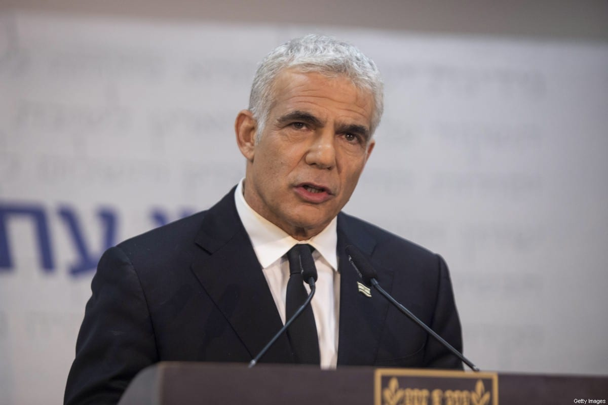 Yair Lapid, leader of the Yesh Atid party, speaks during a news conference in Tel Aviv, Israel, on Thursday, May 6, 2021 [Kobi Wolf/Bloomberg via Getty Images]