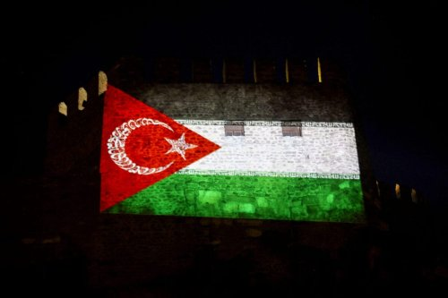 This photograph taken on May 14, 2014 shows a Gaza-Turkey Solidarity flag projected on a wall of Ankara Castle in Ankara [ADEM ALTAN/AFP via Getty Images]