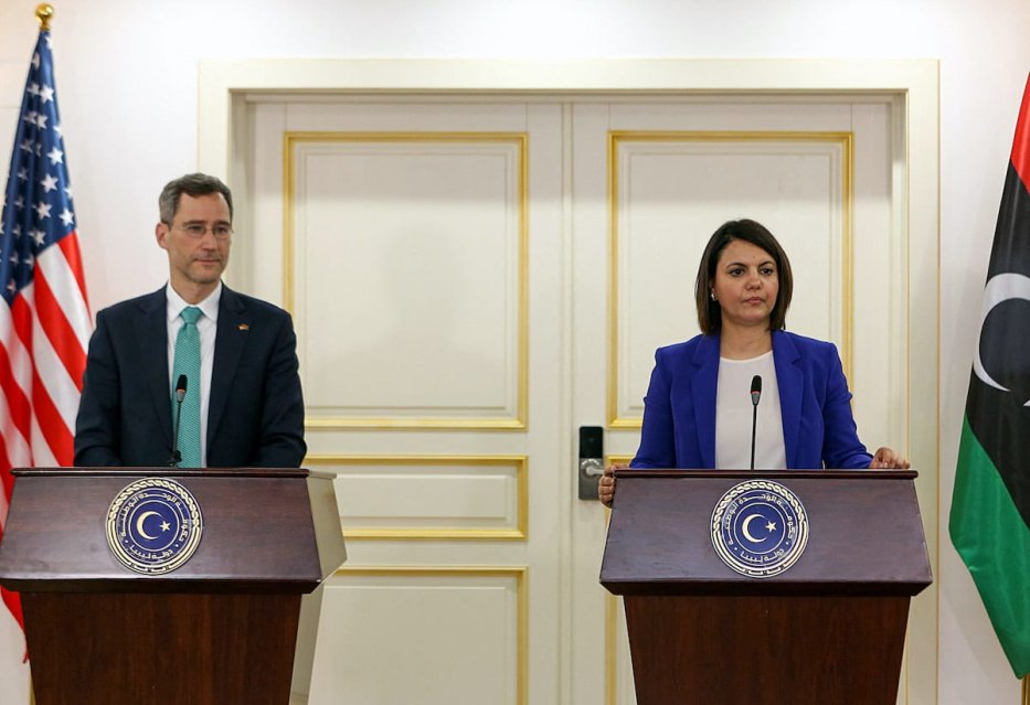 Senior US State Department official Joey Hood and Libyan Foreign Minister Najla al-Mangoush give a press conference in Tripoli on 18 May 2021 during a visit by the US envoy to Libya in a show of support for the country's transitional government. [AFP via Getty Images]