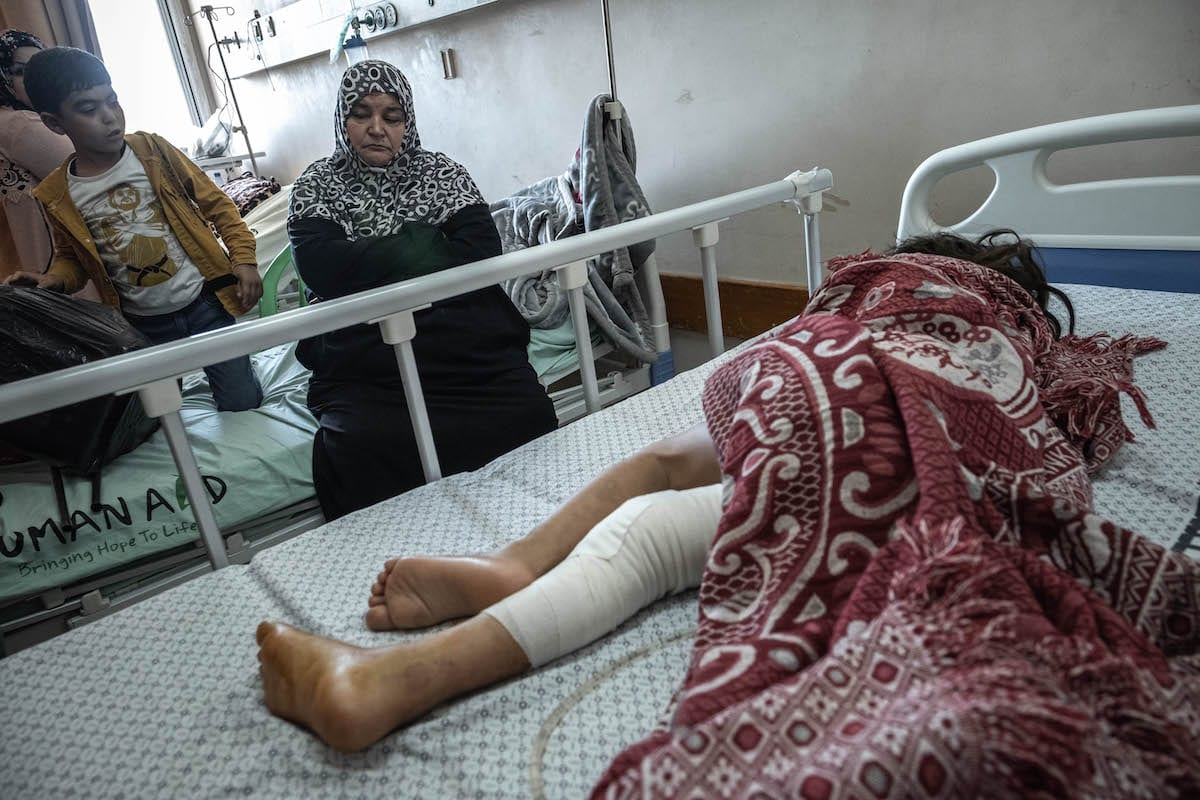 A Palestinian child who was wounded in overnight Israeli air strikes on the Gaza Strip, receives treatment at Al-Shifa Hospital on May 19, 2021 in Gaza City, Gaza. [Fatima Shbair/Getty Images]