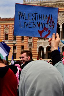 A demonstrator holds a placard reading 'Palestinian lives matter' during a demonstration in support of Palestinians following last week's attacks in Gaza by Israeli armed forces, in Sarajevo, on May 22, 2021 [ELVIS BARUKCIC/AFP via Getty Images]