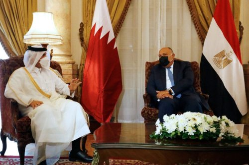Egyptian Foreign Minister Sameh Shoukry (R) meets with Qatar's Deputy Prime Minister and Minister of Foreign Affairs Mohammed bin Abdulrahman bin Jassim Al-Thani in Cairo, on May 25, 2021 [KHALED DESOUKI/AFP via Getty Images]