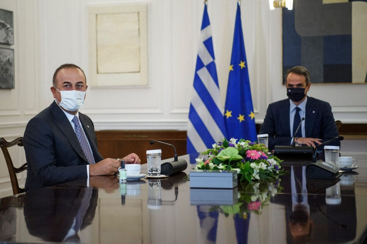 Turkish foreign Minister Mevlut Cavusoglu (L) meets with Greek Prime Minister Kyriakos Mitsotakis (R) in Athens on May 31, 2021 [ANGELOS TZORTZINIS/AFP via Getty Images]