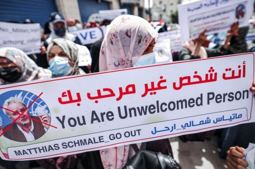 Members of the Union of Arab Employees gather for a demonstration outside the headquarters of the United Nations Relief and Works Agency for Palestine Refugees in the Near East (UNRWA) in Gaza City on 31 May 2021 to demand the expulsion of its Gaza director of operations, Matthias Shmale, over his remarks on the recent conflict between Israel and the Gaza-based Islamist Hamas movement. [MOHAMMED ABED/AFP via Getty Images]