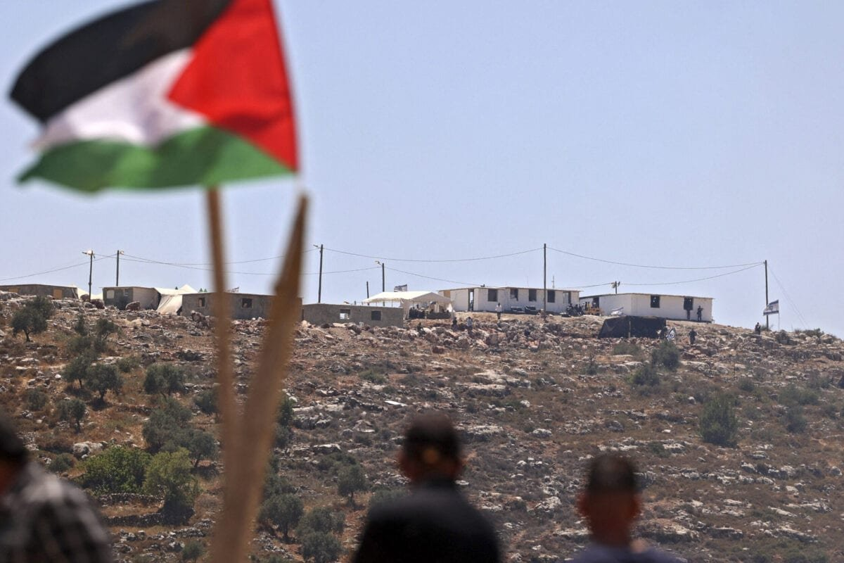 Palestinian protestors attend a demonstration against settlement expansion in the village of Beita, south of Nablus, on June 4, 2021, in the occupied West Bank [JAAFAR ASHTIYEH/AFP via Getty Images]