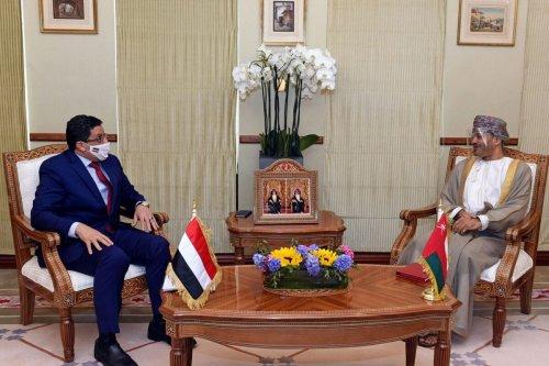 Omani Foreign Minister Sayyid Badr bin Hamad bin Hamood Al-Busaidi (R) meets with his Yemeni counterpart Ahmad Awad Bin Mubarak in Oman's capital Muscat on June 6, 2021 [MOHAMMED MAHJOUB/AFP via Getty Images]