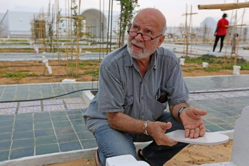 """Algerian artist Rachid Koraichi is pictured at the """"Jardin d'Afrique"""", or Garden of Africa, a cemetery in southern Tunisia for migrants who drowned crossing the Mediterranean in the hope of a better life in Europe, on June 1, 2021 in the southern Tunisian port of Zarzis, near the Libyan border [FATHI NASRI/AFP via Getty Images]"""