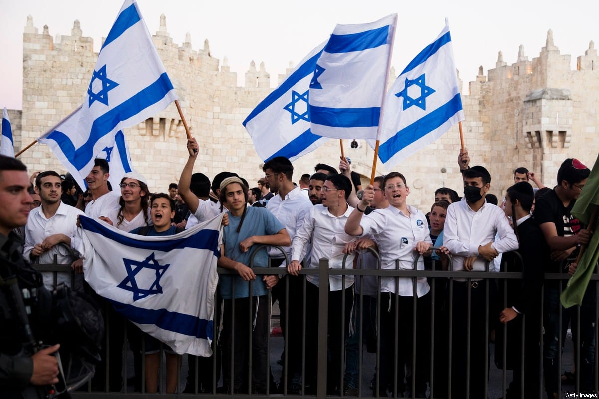 JERUSALEM, ISRAEL - JUNE 15: Israelis hold flags as they march near Damascus Gate during the flag march on June 15, 2021 in Jerusalem, Israel. Authorities had denied permission for the march several times, worried that its route through the Old City would stoke tensions that have been high since, and preceding, the 11 days of fighting between Israel and Hamas last month. (Photo by Amir Levy/Getty Images)