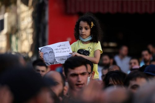 A young Palestinian girl takes part in a march to protest the death of human rights activist Nizar Banat (image) while in the custody of Palestinian Authority (PA) security forces, in the West Bank city of Ramallah, on June 27, 2021 [ABBAS MOMANI/AFP via Getty Images]