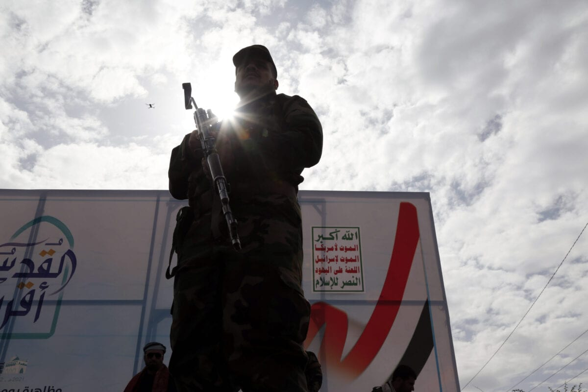 A Houthi security soldier stands guard during a rally marking International Quds Day on May 07, 2021 in Sana'a, Yemen [Mohammed Hamoud/Getty Images]
