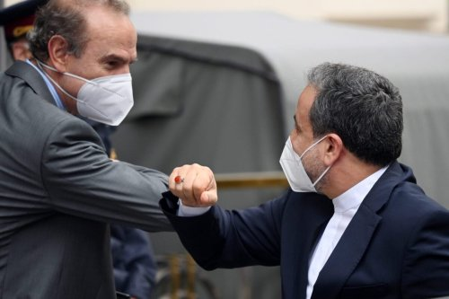 Iranian Deputy Foreign Minister Abbas Araghchi is greeted by Enrique Mora, Deputy Secretary-General of EEAS, as he arrives at the Grand Hotel on the day the JCPOA Iran nuclear talks are to resume on May 25, 2021 in Vienna, Austria [Thomas Kronsteiner/Getty Images]