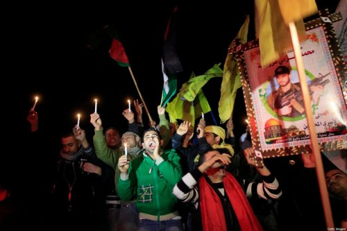 Palestinians celebrate as they wait for the release of Palestinian prisoners in Rafah, crossing in southern Gaza strip, on December 18, 2011. [MAHMUD HAMS/AFP via Getty Images]