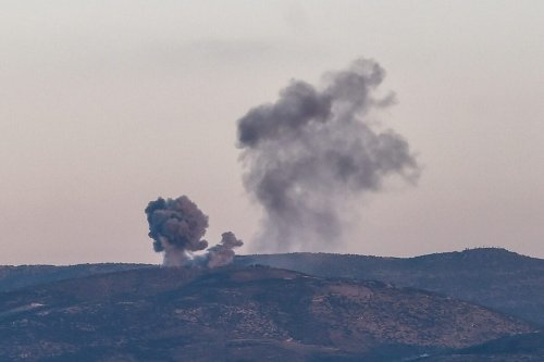 This photo taken on January 28, 2018 shows smoke rising on the Syrian side of the border from Hassa, near Hatay, southern Turkey, as Turkish jet fighters hit People's Protection Units (YPG) positions [OZAN KOSE/AFP via Getty Images]