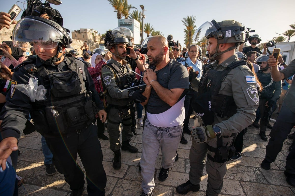 Israeli forces take a Palestinian into custody at Damascus Gate in Jerusalem on June 10, 2021 [Eyad Tawil/Anadolu Agency]