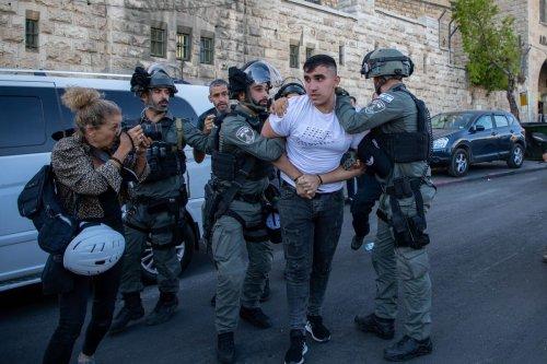 Israeli forces arrest a Palestinian man in Jerusalem on 10 June 2021 [Eyad Tawil/Anadolu Agency]