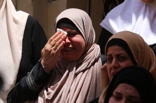 Palestinians mourn at the funeral for Lieutenant Adham Elewi was shot dead by Israeli forces in the West Bank on 10 June 2021 [Nedal Eshtayah/Anadolu Agency]